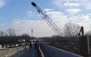 Crane boom drops on highway