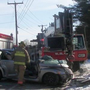 Crane hits car in Maine