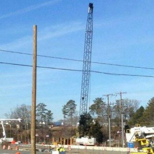 Unstable crane closes road